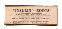 Bottle of insulin in cardboard box, with beige label printed in black