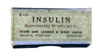 Bottle of insulin, in cardboard box with green label printed in black