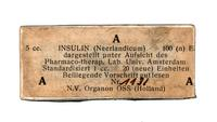Bottle of insulin, in cardboard box, with white label printed in black