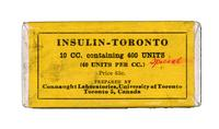 Bottle of insulin in cardboard box, with yellow label printed in black