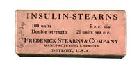 Bottle of insulin, in sealed cardboard box with pink label printed in black