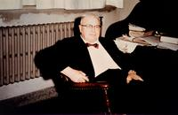 Photograph of J. B. Collip sitting at his desk ca. 1963
