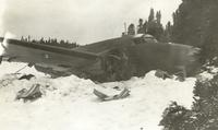 Photograph of a crashed airplane, front and side view, 02/1941