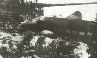Photograph of a crashed airplane, side view, 02/1941