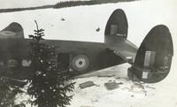 Photograph of a crashed airplane, back view, 02/1941