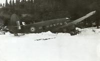 Photograph of a crashed airplane, back and side view, 02/1941