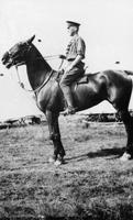 Photograph of C. H. Best in uniform on horseback ca. 1918