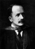 Photograph of J. J. R. Macleod in academic robes ca. 1923