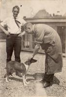 Photograph of F. G. Banting and C. H. Best with a dog on the roof of the Medical Building