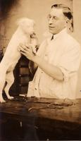 Photograph of F. G. Banting with white dog