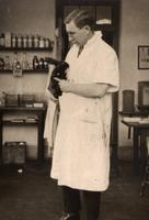 Photograph of F. G. Banting holding a rabbit